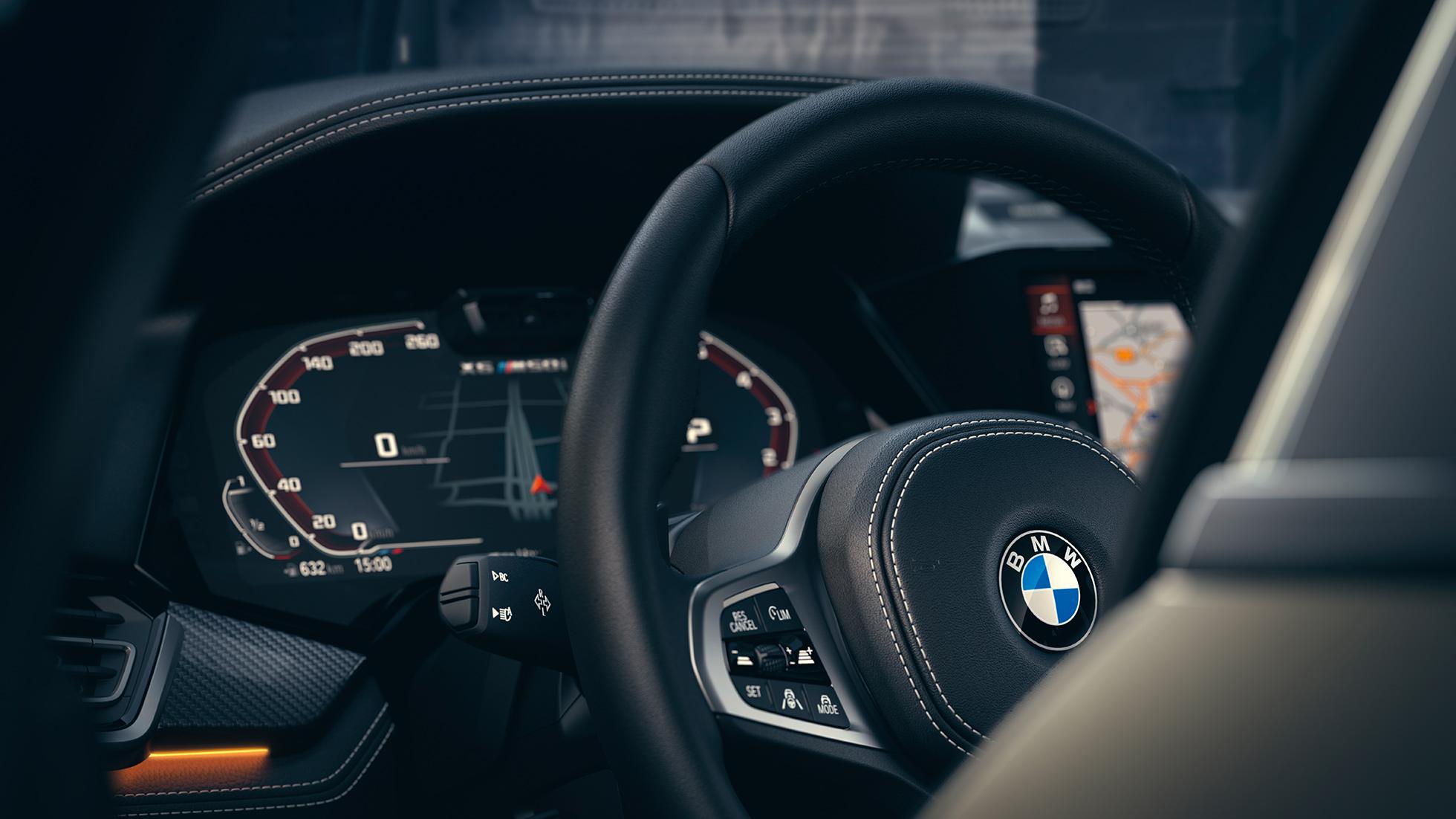 Интерьер BMW , крупный план с фокусировкой на панели приборов