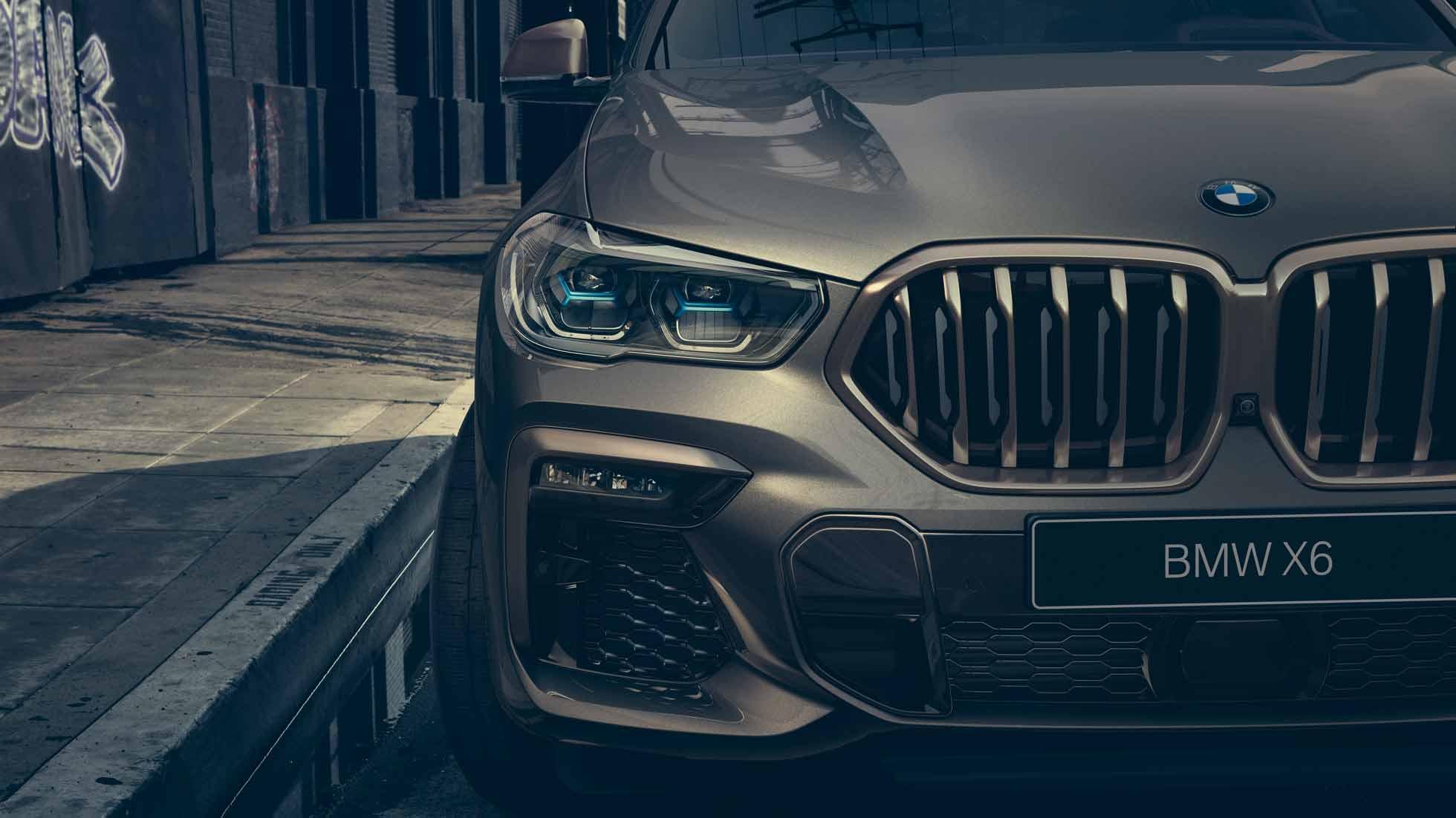Крупный план BMW X6 с фокусировкой на лазерные фары BMW Laserlight